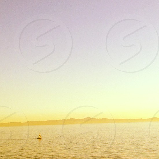 sail boat on sea under clear blue sky photography  photo