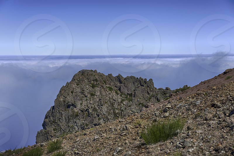 clouds above on the high mountains at madeira island called pico arieiro the top is 1818 meters above sea level photo