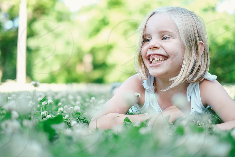 Happy 7-year-old girl in the park photo
