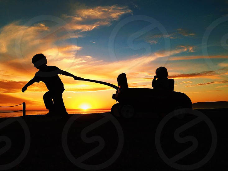 silhouette of playing children photo