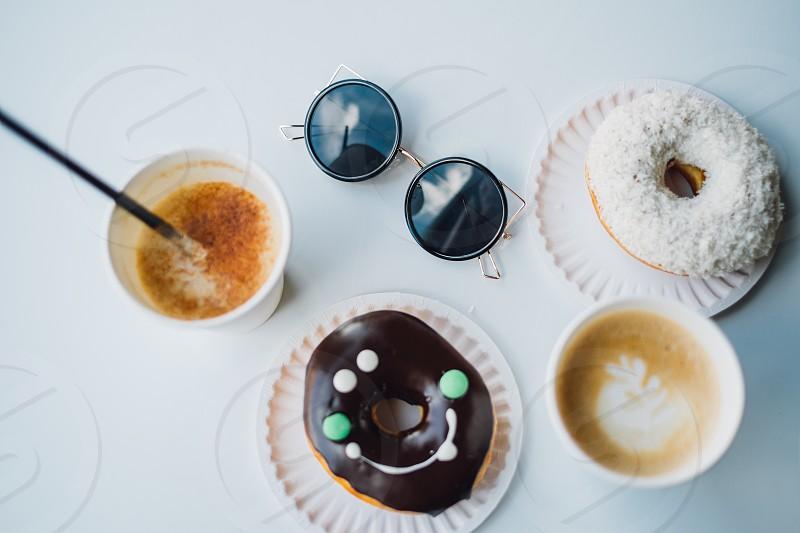 Happy donut with coffee photo