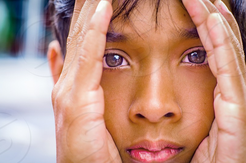 Boy with hands on face photo