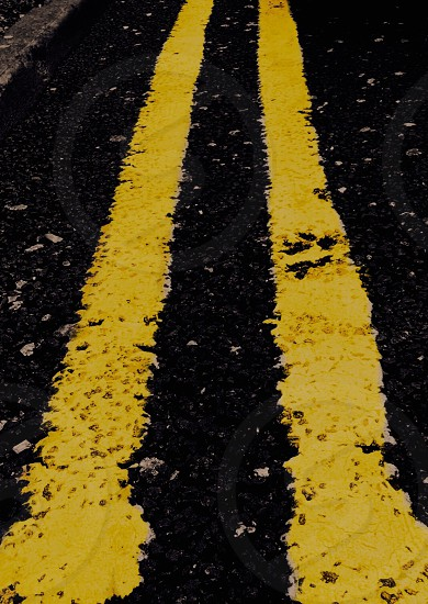 Double yellow lines road abstract gritty urban photo