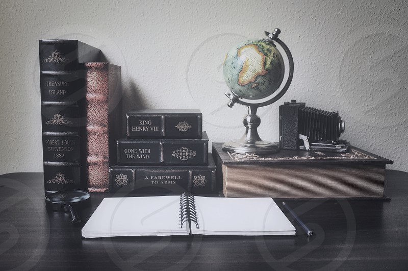 an open spiral notebook on table photo