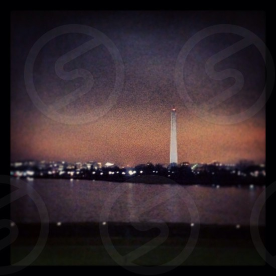 Washington monument at night from tidal basin photo