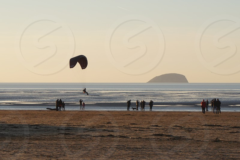 paragliding on a winter beach photo