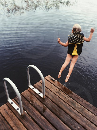 girl jumping into the water photo