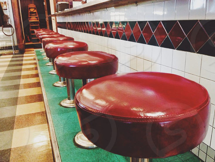 round red-brown vinyl stools with silver base photo