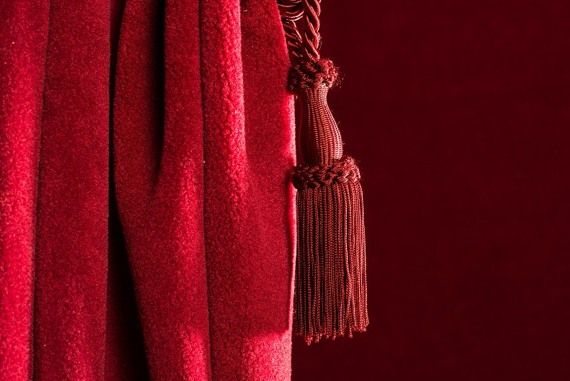 Red theatre curtain and red tassels photo