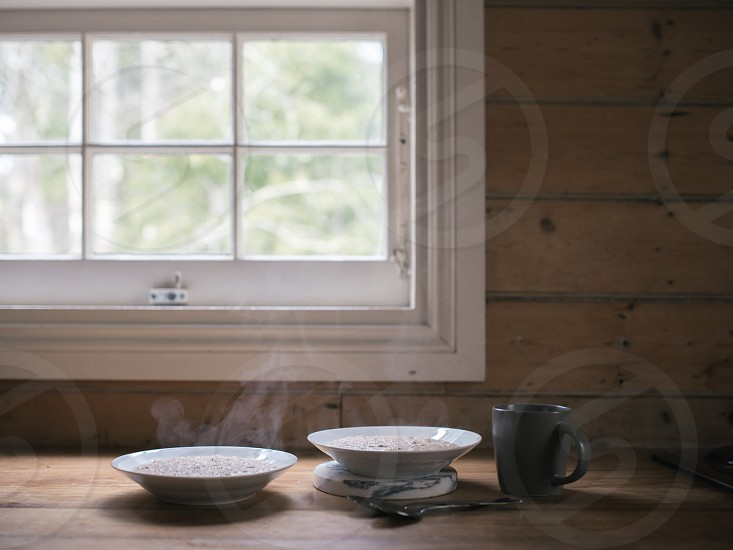 A hot bowl of porridge and coffee - the perfect way to stay warm in the winter months photo