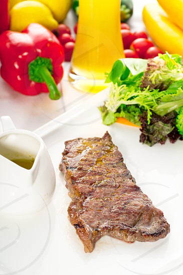 juicy BBQ grilled rib eye ribeye steak vegetables and lagher beer on background MORE DELICIOUS FOOD ON PORTFOLIO photo