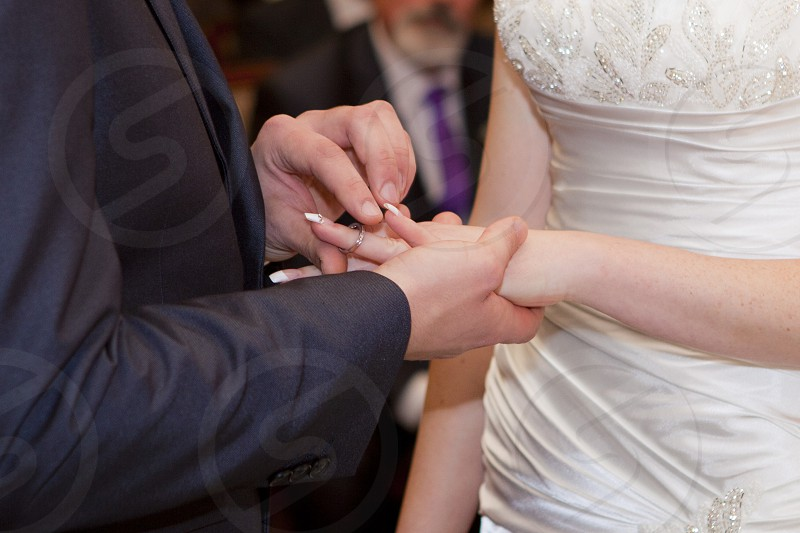 Placing of the ring on the Brides hand photo