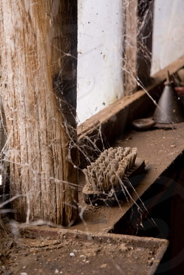 Closer shot of cobwebbed windows in an old barn or could be men's shed or garage photo