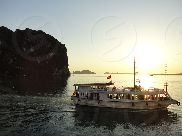ferry in water by rocks photo