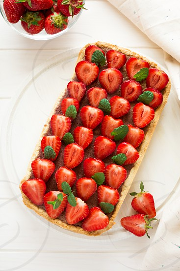 tart french background white cake strawberry dessert snack gourmet tasty colorful pastry fancy food berry delicious sweet red homemade baking pie treat healthy bakery cream sugar wooden fruit fresh organic lunch rustic vegetarian meal ripe natural vegan decorated yummy summer dinner tartlet confectionery cooking recipe short home cuisine galette baked photo