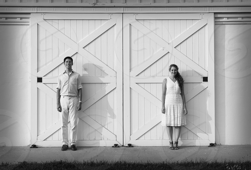 man and woman standing near white door photo