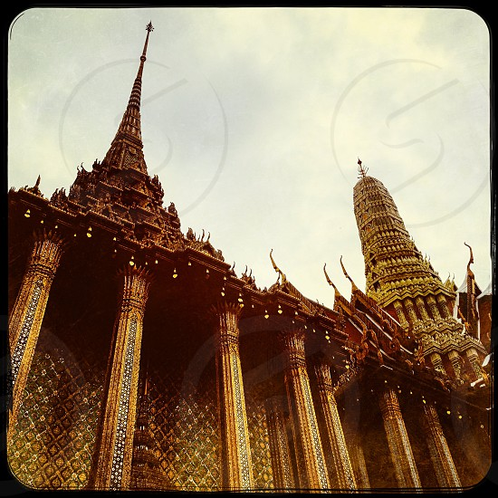 Outdoor day colour Grand Palace Bangkok Thailand Kingdom temple shrine monument Buddhist Buddhism holy religious religion royal regal king east eastern Far East travel tourism tourist wanderlust mosaic tile decor decoration elaborate ornate gold emerald gold leaf architecture square filter photo