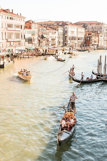 Gondola Rides At Grand Canal In Venice Italy photo