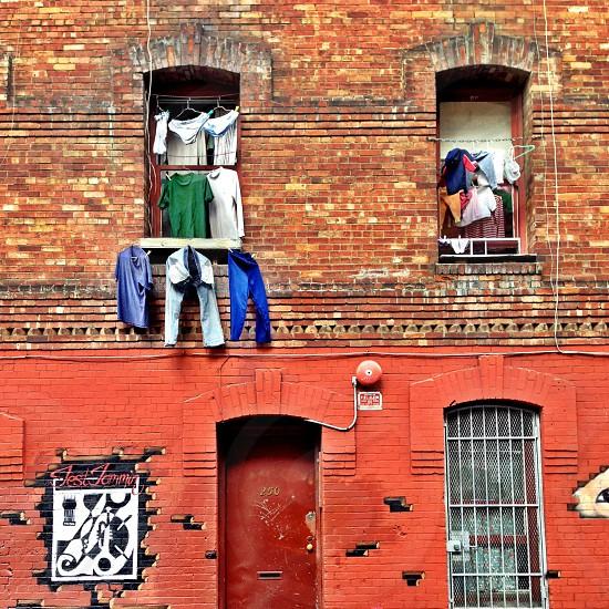 Chinatown laundry day brick building photo