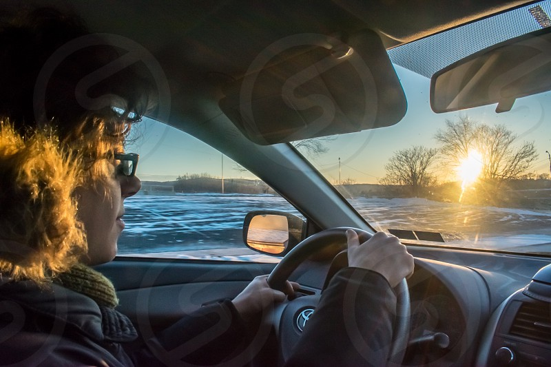 Driving sunset winter snow Toyota corolla dusk field trees low light car interior steering wheel windshield dashboard photo