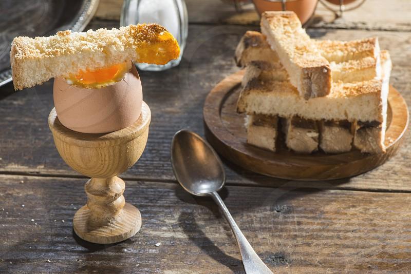 Soft-boiled egg on the table. Boiled egg on breakfast photo