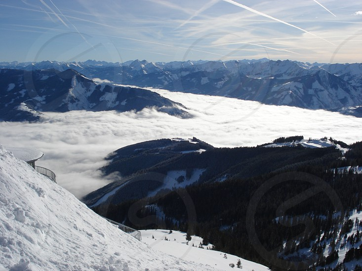 mountains covered with snow under white and blue sky at daytime photo