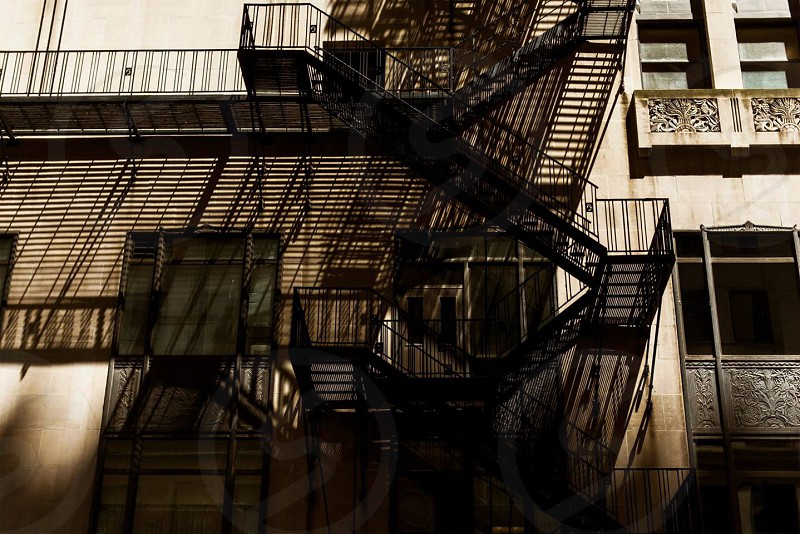 black metal building fire exit staircase photography photo