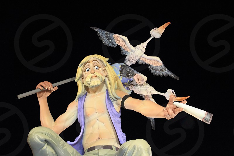 fallas popular fest from Valencia with figures sculptures over black night sky in Spain photo