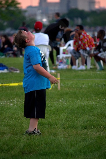 boy standing in grass photo