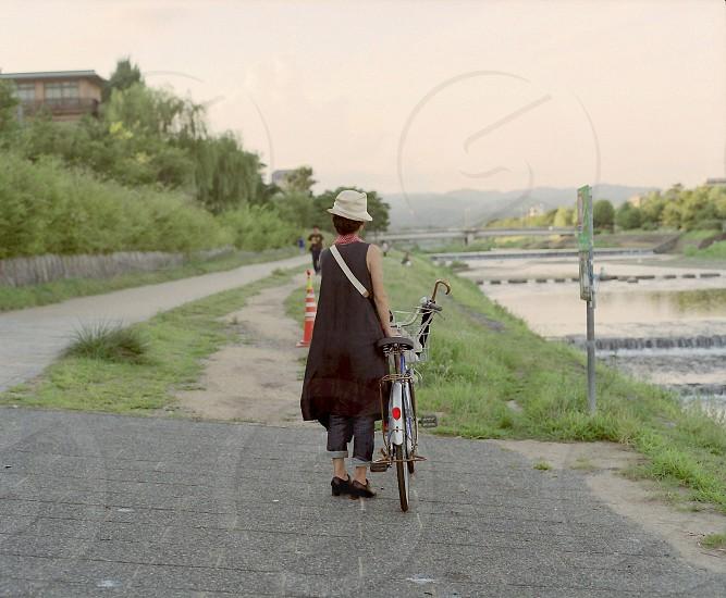 woman beside a bike photo