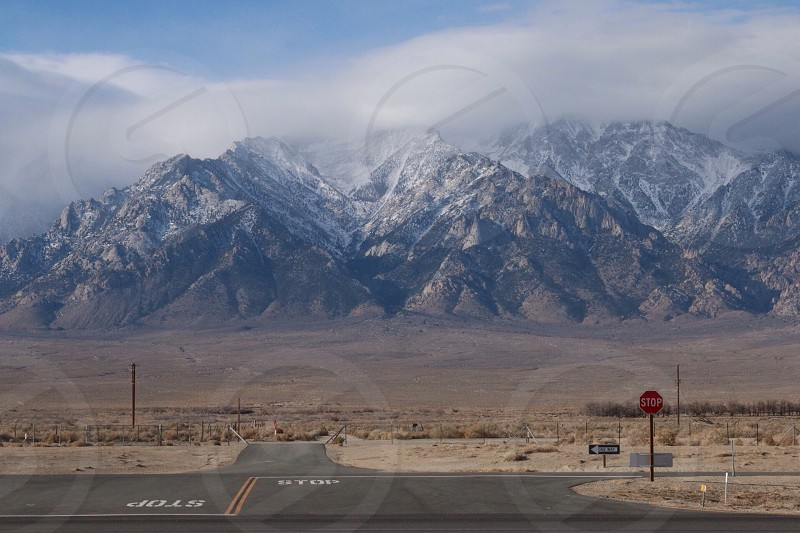 empty concrete road with mountain alps background photo