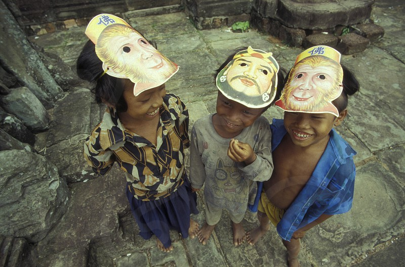 childern in a temple in Angkor at the town of siem riep in cambodia in southeastasia.  photo