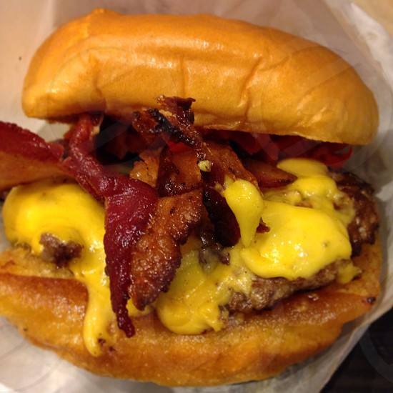 American burger with cheese and bacon photo