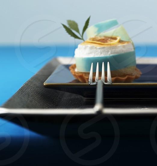 Lemon tart on blue background. photo