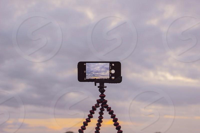 black smartphone on tripod photo
