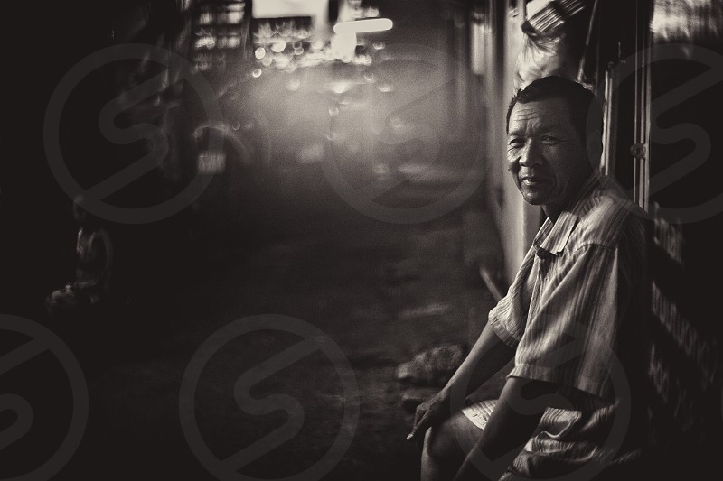 Street life old Vietnamese man sitting photo