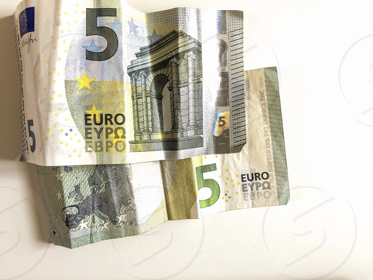 five euro banknote on a white background photo