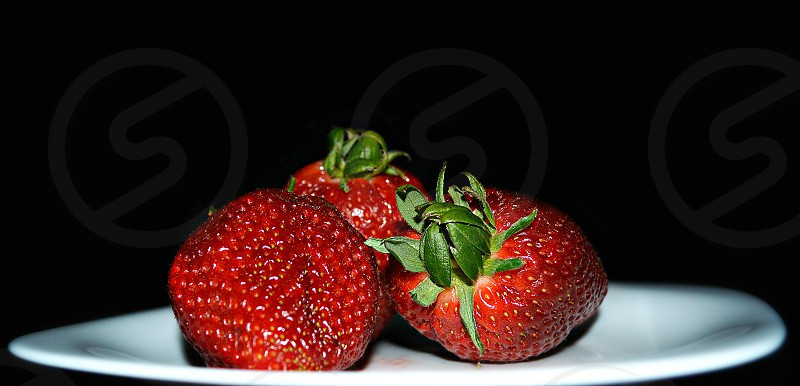 Strawberries on the plate photo