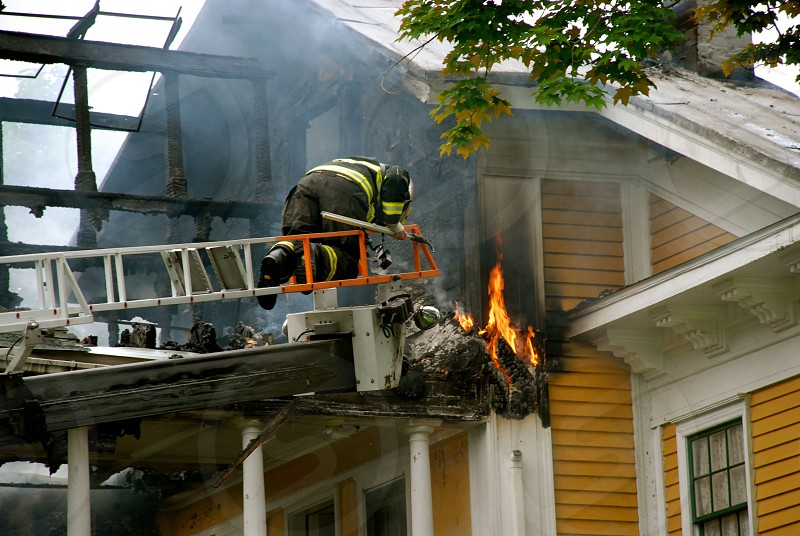 House Fire Fireman on ladder photo