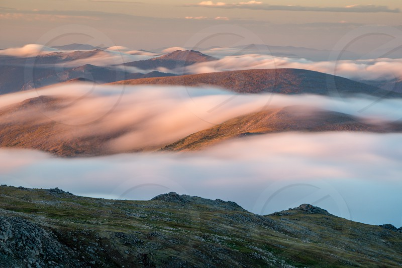 Foggy Sunrise from Mount Evans in Colorado. photo