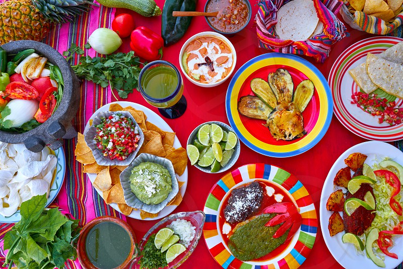 Mexican recipes mix on a colorful table with sauces from Mexico photo