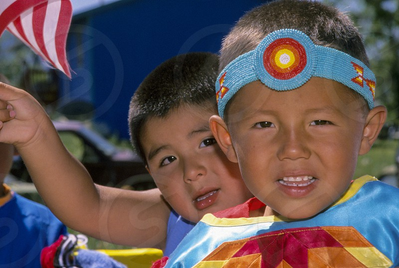 Close up of two first nations boys dressed in traditional beaded headband during a July 4th parade Arlee Montana photo