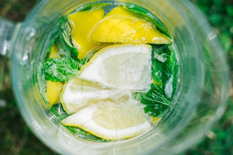 lemonade in clear drinking glass during daytime photo