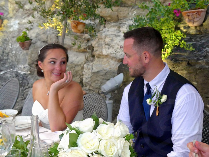 Casting loving glances at the reception table after a beautiful Italian wedding. photo