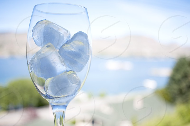 Ice Cubes fill a wine glass. photo
