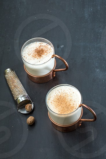 copper and glass mugs with whiskey punch photo