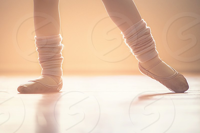 person in grey ballets shoes photo