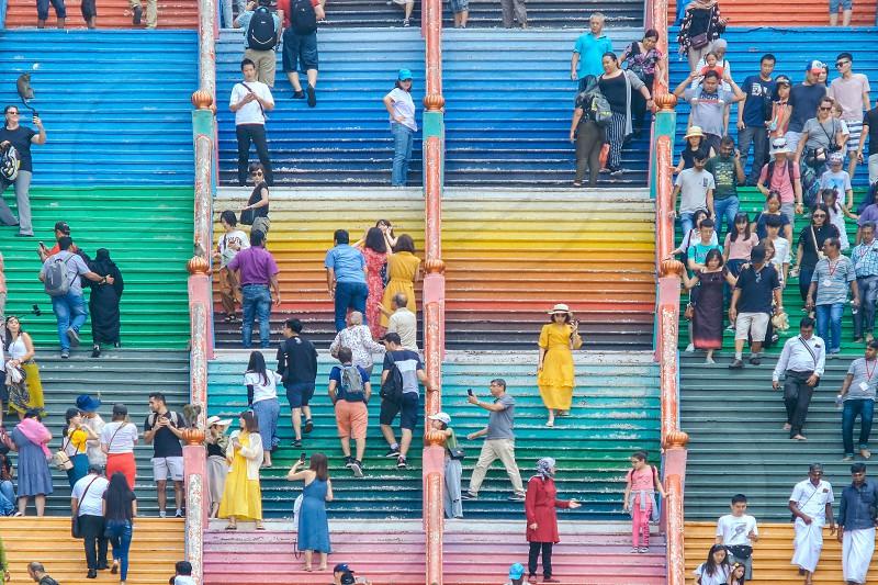 Tourists on Batu Caves 272 colorful steps photo