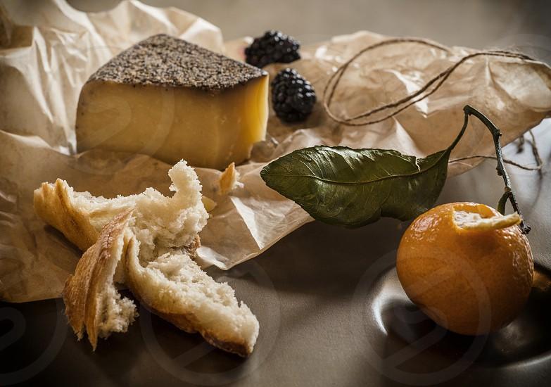 Stiil life breadfruit and cheese. photo
