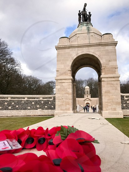 Outdoor day vertical portrait colour Delville Wood Somme France Europe European Battle Western Front World War One WWI WW1 First World War battleground war warfare trench Trenches memorial remembrance commemoration stone carved Canada Canadian mourning monument sky clouds blue photo